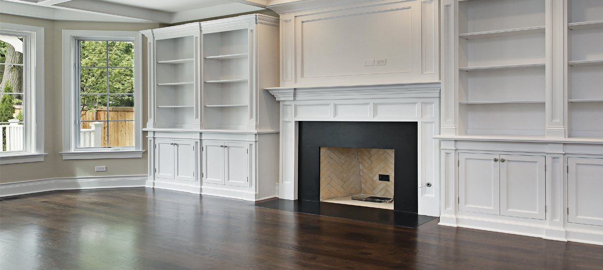 white painted cabinet book shelves and fireplace