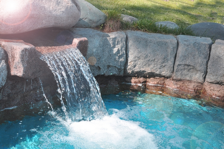 You can use rock formations to create a waterfall around the pool landscaping.