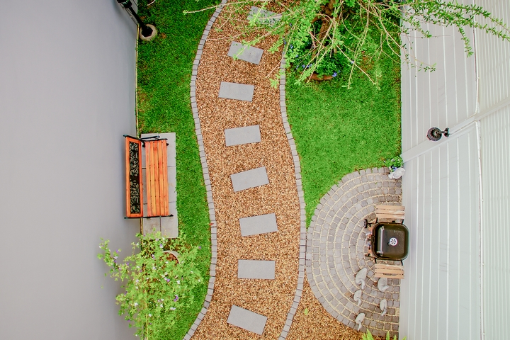 Creating a focal point with pathways is one of the creative backyard ideas.