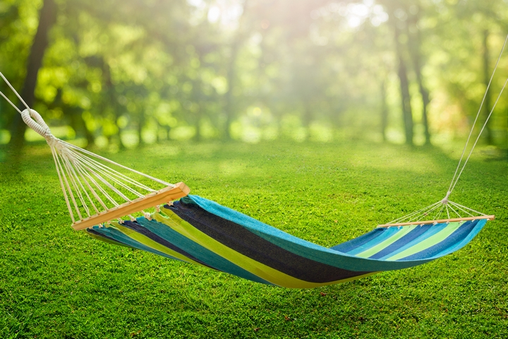 Hanging a hammock is one of the creative backyard ideas.