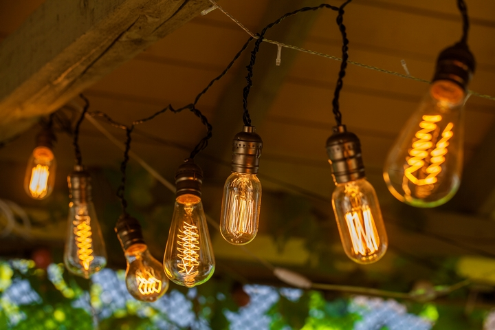 Hanging string lights is one of the creative backyard ideas.