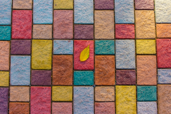 Laying colourful tiles is one of the creative backyard ideas.